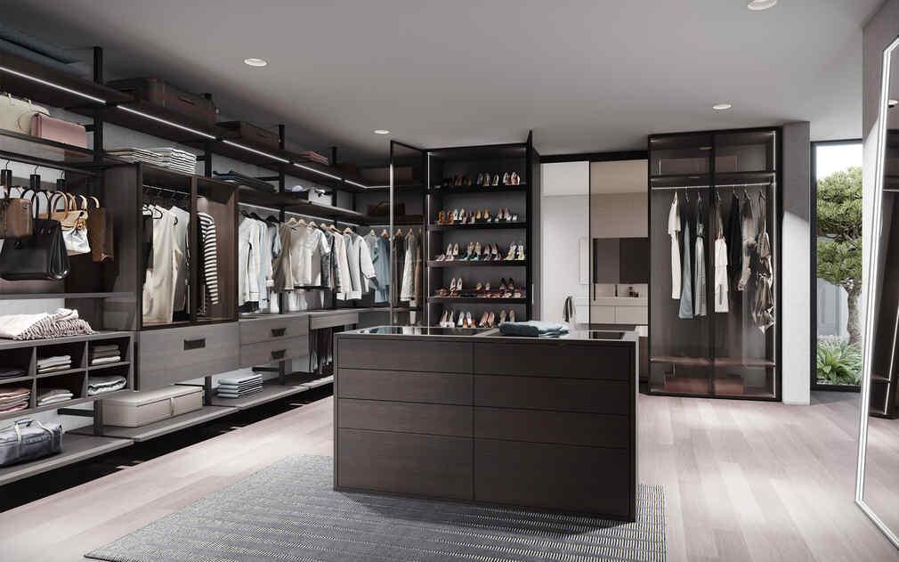 Ankleidezimmer mit Mittelinsel, Regalen und Schubladen in einem Säulensystem - als Durchgangsraum von der Marke Raumplus