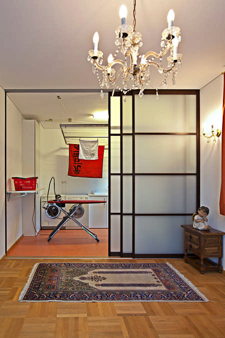 Schiebetüren als Raumteiler für Waschküche mit Massivholzrahmen Feldkirch 1